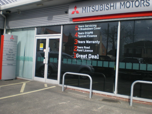 Magic Blackout Blind used by Mitsubishi for sales event to blackout car showroom windows